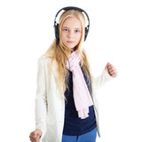 Blond girl with a headphones. Listening to music and dancing. Stock Photo