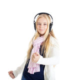 Blond girl with a headphones. Listening to music and dancing. Stock Images