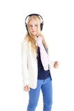 Blond girl with a headphones. Listening to music and dancing. Stock Photos