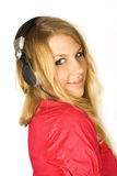 Blond girl in headphones smiling isolated Royalty Free Stock Images