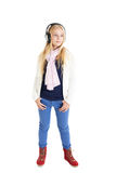 Blond girl with a headphones. Closed eyes. Royalty Free Stock Photo