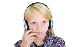 Blond girl with headphones Royalty Free Stock Photos