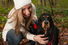 Blond girl and her dog Stock Images