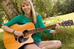 Blond girl and her instrument Stock Image