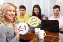 Blond girl and her team of developers Royalty Free Stock Image
