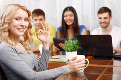 Blond girl and her team of developers Stock Photography