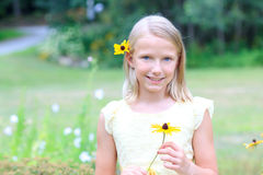 Blond Girl Holding a Flower Stock Image