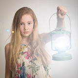 Blond Girl Holding a Lantern. Royalty Free Stock Photos