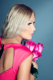 Blond girl with roses Stock Images