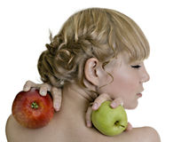 Blond girl holding two apples Stock Image