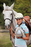 Blond girl with horse Stock Photography