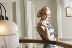 Blond girl with hotel keys. Blond woman very nice , posing in elegant and keeping hotel room keys in one hand. she is smiling Stock Photo