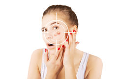 Blond girl hunting for acne on her skin Stock Photo
