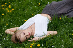 Blond Girl In Grass Royalty Free Stock Image