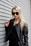Blond Girl In Leather Outfit Stock Photos