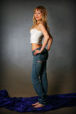 Blond girl in jeans Royalty Free Stock Image