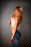 Blond girl in jeans Royalty Free Stock Photos