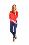 Blond girl in jeans standing. Royalty Free Stock Images