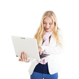Portrait of a surprised blond girl with a laptop. Royalty Free Stock Photography
