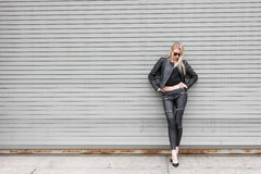 Blond Girl in Leather Outfit Stock Image