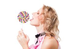 Blond girl lick lollipop Stock Images