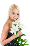 Blond girl with a lily Royalty Free Stock Photos
