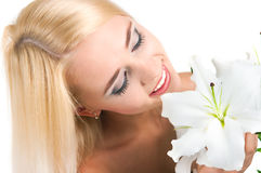 Blond girl with a lily Royalty Free Stock Photography