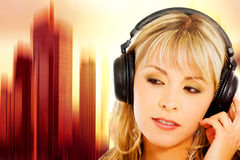 Blond girl listening to music Stock Image