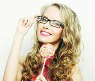 Blond  girl with  lolipop Royalty Free Stock Images