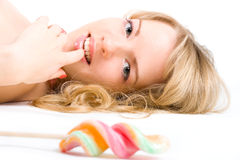 Blond girl with lollipop Stock Photos