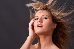 Blond girl with long hair Royalty Free Stock Photos