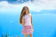 Blond girl looking blue Mediterranean sea tourist Royalty Free Stock Images
