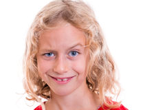 Blond girl looking funny with eyebrow up Stock Images