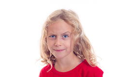 Blond girl looking skeptical with eyebrow up Royalty Free Stock Photography