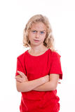 Blond girl looking skeptical with eyebrow up Stock Photo