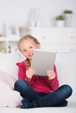 Blond girl looking beside tablet-computer Royalty Free Stock Photo