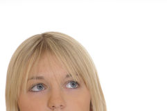 Blond girl looks up Royalty Free Stock Image