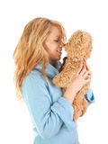 Blond girl loves teddy bear Royalty Free Stock Photo