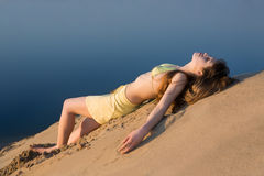 Blond girl lying on the beach Royalty Free Stock Image