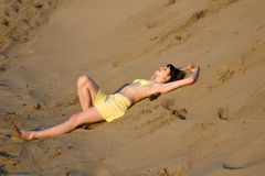 Blond girl lying on the beach Stock Image