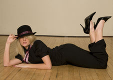 Blond girl lying on floor Royalty Free Stock Images