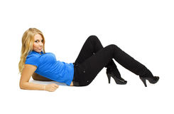Blond girl lying and looking at camera Stock Images