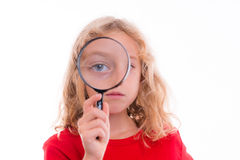 Blond girl with magnifying glass Royalty Free Stock Image