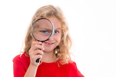 Blond girl with magnifying glass Royalty Free Stock Images