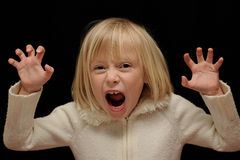 Blond girl making scary face Stock Photo