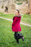 Blond Girl in Maroon Coat Royalty Free Stock Image