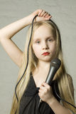 Blond girl with microphone Stock Photo