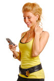 Blond girl with a mobile phone Royalty Free Stock Photos