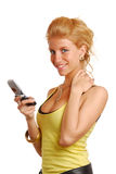 Blond girl with a mobile phone Royalty Free Stock Image