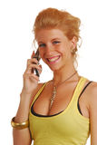Blond girl with a mobile phone Royalty Free Stock Photo